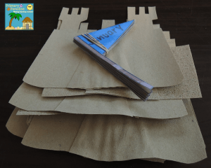 Sand paper sandcastles for beach themed birthday board 10
