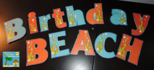 Sand paper sandcastles for beach themed birthday board 13